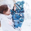 Little preschool boy and his mother playing with first snow in p — Stock Photo #38239999