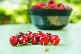 Fresh ripe organic red cherries in summer garden — Stockfoto