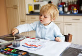 Adorable boy of two years drawing with paints. — Stock Photo