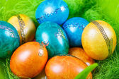 Colorful easter eggs in nest as traditional detail of Easter hol — Stock Photo