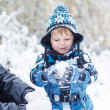 Father and toddler boy having fun with snow on winter day — Stock Photo #39681863