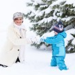 Little preschool boy and his mother playing with first snow in p — Stock Photo #39681307