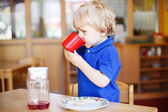 Little boy eating at nursery — Stock Photo