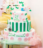 Delicious wedding cake in white , green and pink — Stock Photo