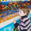 Stock Photo: Little boy of three years at funfair, outdoors