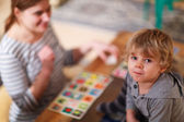 Mother and little son playing together education card game for c — Stock Photo
