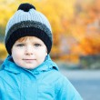 Portrait of adorable toddler boy in warm winter clothes on cold — Stok fotoğraf