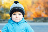 Portrait of adorable toddler boy in warm winter clothes on cold — Stock Photo