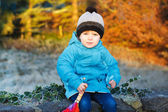Portrait of adorable toddler boy with blue jacket and colorful u — Стоковое фото