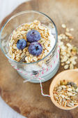 Healthy food: Homemade fresh yogurt with blueberries and muesli — Stock Photo