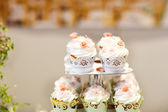 Wedding cake and cupcakes on event or reception party. — Stock Photo