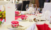 Elegant table set for wedding or event party in pink with dots. — Stock Photo