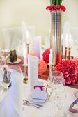 Elegant table set for wedding or event party in soft red and pi — Stock Photo
