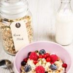 Fresh yoghurt with home made cereals and muesli, fresh raspberry — Stock Photo
