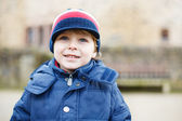 Portrait of cute caucasian toddler boy in warm clothes on cold d — Stock Photo