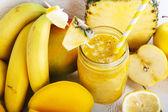 Fresh organic yellow smoothie with banana, apple, mango, pear, p — Stock Photo