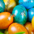 Colorful easter eggs in nest as traditional detail of Easter hol — Stock fotografie #42857709