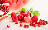 Fresh organic fruits and berrys: rapsberyy, watermelon, pomegran — Stock Photo