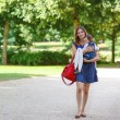 Beautiful mother and little daughter walking in summer park — Stock Photo