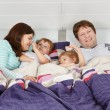 Happy family of a four having fun at home — Stock Photo
