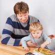 Father and little boy of two years having fun painting — Stock Photo #43018473