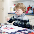 Adorable toddler boy having fun indoor, painting with different — Stock Photo #43018723