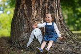 Little cute baby girl having fun in summer park — Stock Photo