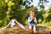 Little baby girl eating fresh apple in summer park. — Stock Photo