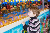 Little boy of three years at a funfair, outdoors — Stock Photo