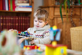 Little toddler boy playing with wooden railway, indoors — Photo