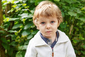 Smiling little toddler boy outdoors portrait. — Stock Photo