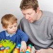 Little boy and his mother being happy about selfmade Easter eggs — Stock Photo