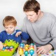 Little boy and his mother being happy about selfmade Easter eggs — Stock Photo #43367063