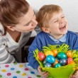 Little boy and his mother being happy about selfmade Easter eggs — Stock Photo #43777451