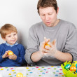 Little boy and his mother being happy about selfmade Easter eggs — Stock Photo #43777509