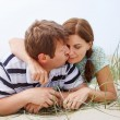 Young happy couple in love having fun on sand dunes of the beach — Stock Photo