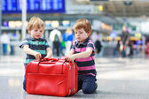 Two brother boys going on vacations trip at airport — Stock Photo