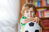 Little boy watching football cup game on tv. — Stock Photo