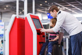 Father and little son at the airport, traveling together — Stock Photo