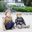 Two little children sitting on beach of river Elbe and playing t — Stock Photo #46979485