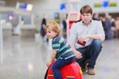 Father and little son at the airport — Stock Photo