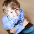 Portrait of adorable little boy with blond hairs and blue eyes — Stock Photo #46981023
