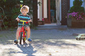 Little toddler boy of 3 years having fun on his  bicycle — Stock Photo