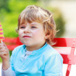 Happy little toddler boy eating colorful ice cream in summer — Stock Photo #47552903