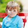 Happy little toddler boy eating colorful ice cream in summer — Stock Photo #47552923