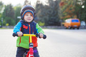 Little toddler boy learning to ride on his first bike  — Stock Photo