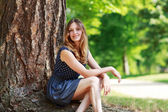 Portrait of young beautiful woman in summer forest — Stock Photo