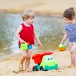 Little toddler boy and girl playing together with sand toys — Stock Photo #48269383