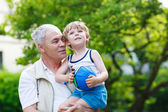Active grandfather playing with little grandson ball — Stock Photo