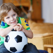 Cute boy fan having fun and happiness for football game — Stock Photo #48616823